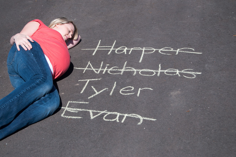 The progression of baby names that they went through, written in chalk on a tennis court beside their house.