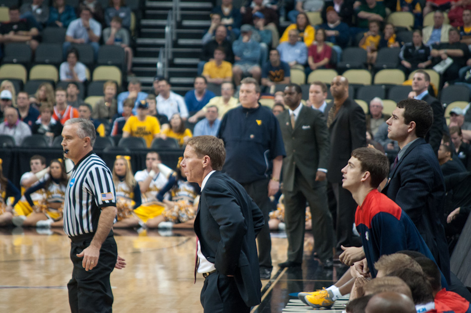 Gonzaga coach Mark Few looks on as his Bulldogs take on the West Viginia Mountaineers, March 15, in Pittsburgh. West Virginia coach Bob Huggins can be seen in the background.