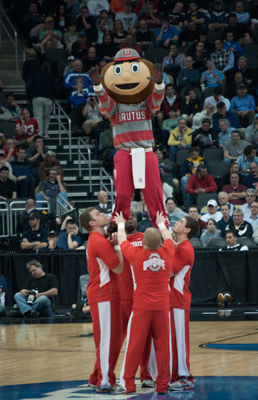 The Ohio State Buckeyes mascot, Brutus, is held up at center court by Buckeye cheerleaders; March 15, Pittsburgh.