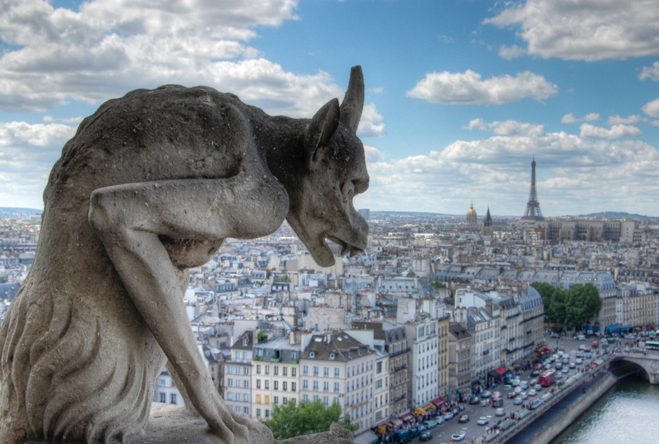 Another Notre Dame gargoyle over looking Paris. In the distance, the Eiffel Tower can be seen, along with the gold-domed Les Invalides, burial place of Napoleon.