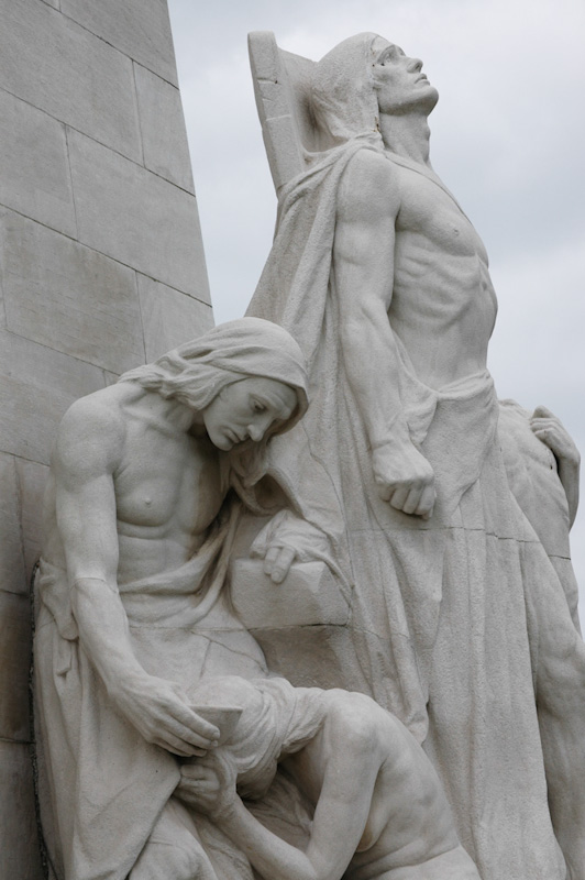 "A close-up of the Vimy Ridge Memorial ""Sympathy of the Canadians for the Helpless"" statue. The Vimy Ridge memorial grounds - as well as the preserved 250 acre battle grounds surrounding the area, have been given in perpetuity to Canada by the government of France."