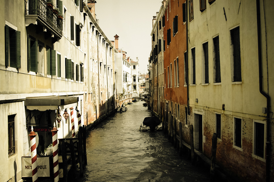 A Venetian canal and bridge, Venice, Italy.