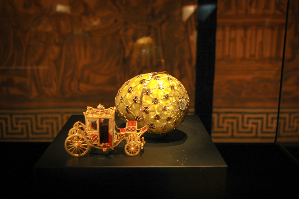The Faberge egg seen here is perhaps the most famous: the Imperial Coronation Egg, created in 1897 to commemorate the coronation of Tsar Nicholas II, of Russia. The coach in front of the egg is an exact replica - complete with moving wheels and opening/closing doors - of the Imperial Coach that carried Tsarina Alexandra to her coronation. This image was taken while the Faberge collection was on display at the Vatican Museums, in the Holy See.
