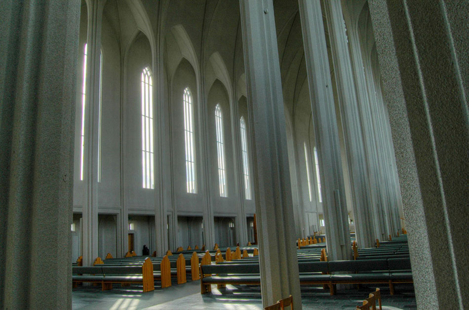 The interior doors of Hallgrimskirkja are decorated in these stained glass globes. In the reflection, you can see the sprawling ceilings of the main hall.