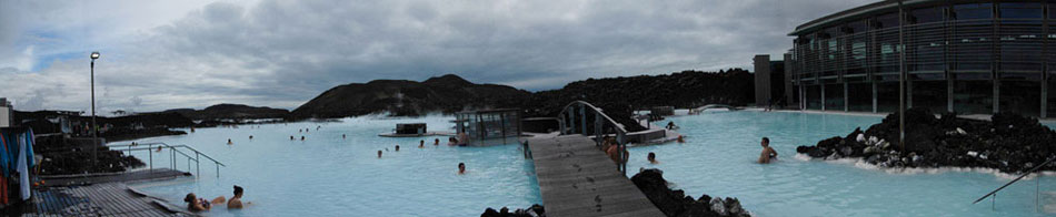 The Blue Lagoon, a thermal hot spring just outside of Reyjkavik, Iceland, is a popular tourist destination for obvious reasons. In this panoramic image of the main swimming area, the white-blue water – the white pigment comes from the naturally-occuring silica on the pool's floor – can be seen. While swimming in the thermal-heated waters, my back tattoo was stared at several times.