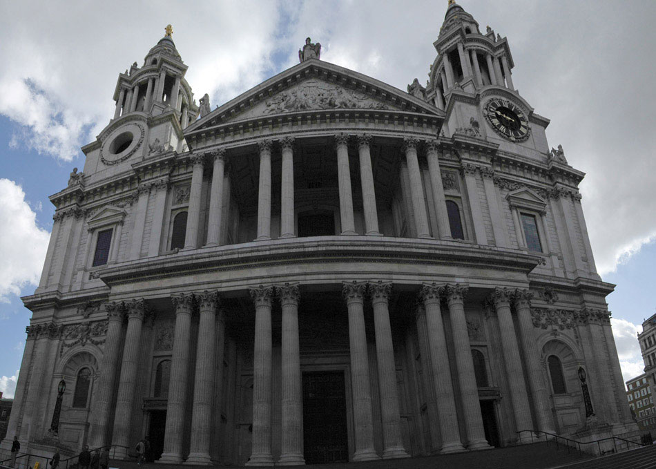One of the largest cathedrals in London, St. Paul's is a popular destination for both tourists and Christians alike. Designed by Sir Christopher Wren, the cathedral sits atop Ludgate Hill, the highest point in London. Seen here in a four-shot panorama, the Great West Door and it's intimidating columns mask the iconic feature of the cathdral, it's massive dome. The cathedral is so iconic, that during World War II, Winston Churchill insisted that all fire-fighting resources be directed to St. Paul's, in order that the cathedral be saved. The highlight of the sprawling cathedral – at least for us – is the Whispering Gallery, a viewing gallery about half-way up the dome. As we discovered, the name is highly accurate: you can whisper into the wall on one side of the gallery and an observer standing 240ft away can hear your voice as if they were standing beside you. A word of caution to the faint-hearted: the climb from the nave to top of the dome is well over 600 stairs.
