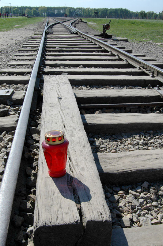 When we arrived at Auschwitz II – also known as Auschwitz-Birkenau – one of the first images I recall was the image above: a single candle, placed in a decorative glass holder, on the tracks the Nazis used to transport thousands to their death. It was a solemn memorial in a place that had seen too much death.