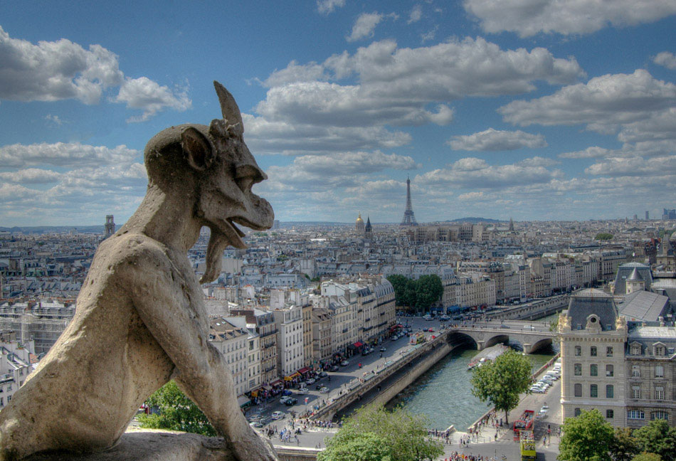 The gargoyles of Notre Dame are one of the highlights of visiting the six hundred year old cathedral. The climb to reach them will have your legs screaming, but in the end is worth it. This gargoyle overlooks some of the major landmarks of Paris, including the Eiffel Tower, Les Invalides (gold dome, image center) and the River Seine below.