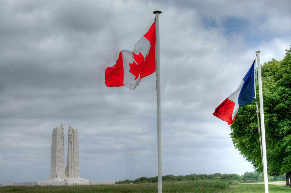 With the Vimy Ridge monument in the background, the flags of Canada and France fly in the foreground. Taken from the parking area, we were fortunate enough to turn around and meet a bus-load of fellow Canadians who had made the trip up to Vimy Ridge. We also met a couple from Burlington, Ontario; literally 20 minutes away from my home town. We went halfway around the world, just to meet someone from our own backyard.