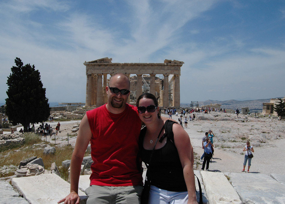 At the highest point in Athens – more climbing – sits the Acropolis of Athens, an ancient settlement, seat of government, garrison headquarters and holy site. Composed of more than 21 buildings, Jamie and I sit in front of the Parthenon, one of the more recognizable features of the area.