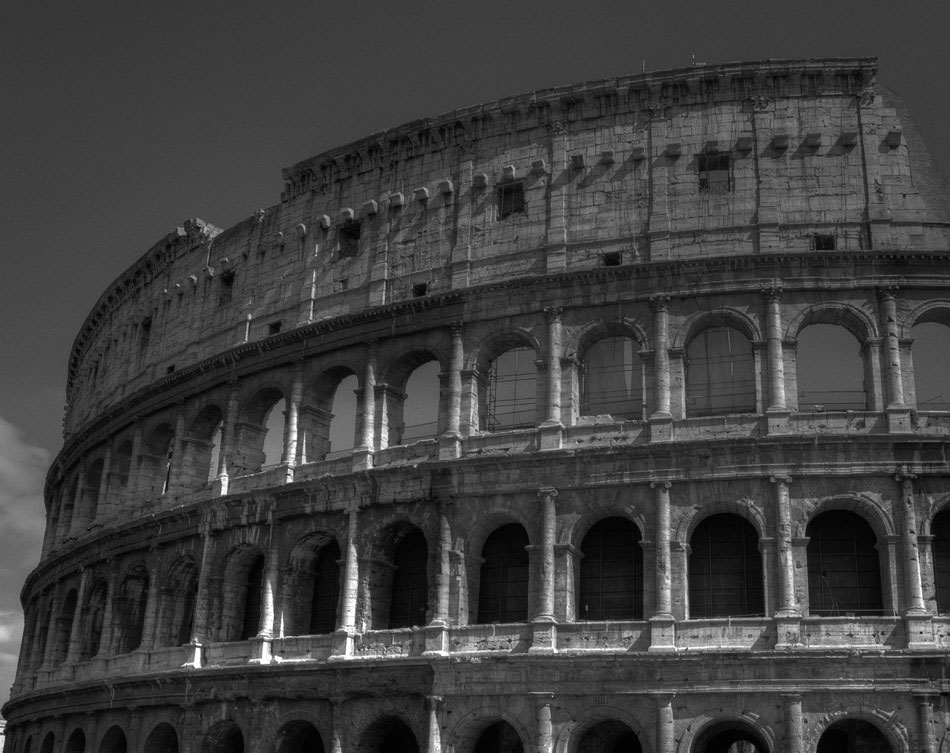 One of the final shots taken on this trip is of the the remaining outer wall of the Colosseum. This black and white photo shows the numerous arches that the ancient structure is famous for, as well as some restoration work on the inner side of the wall.