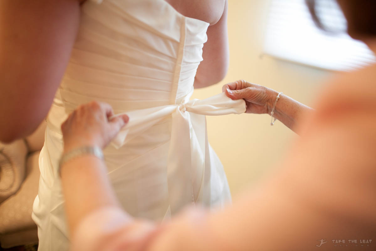 Mommy helping her into her wedding dress.