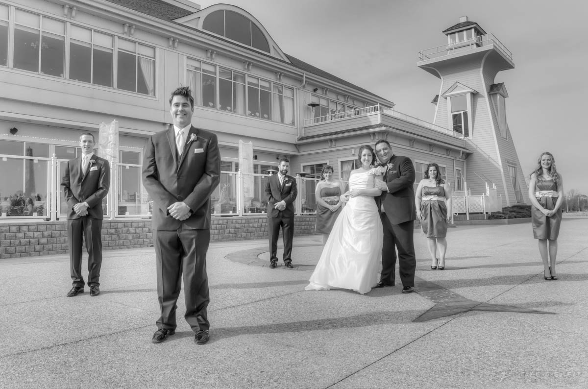 The entire wedding party, shot with the signature lighthouse at Harbour Centre in Oakville.