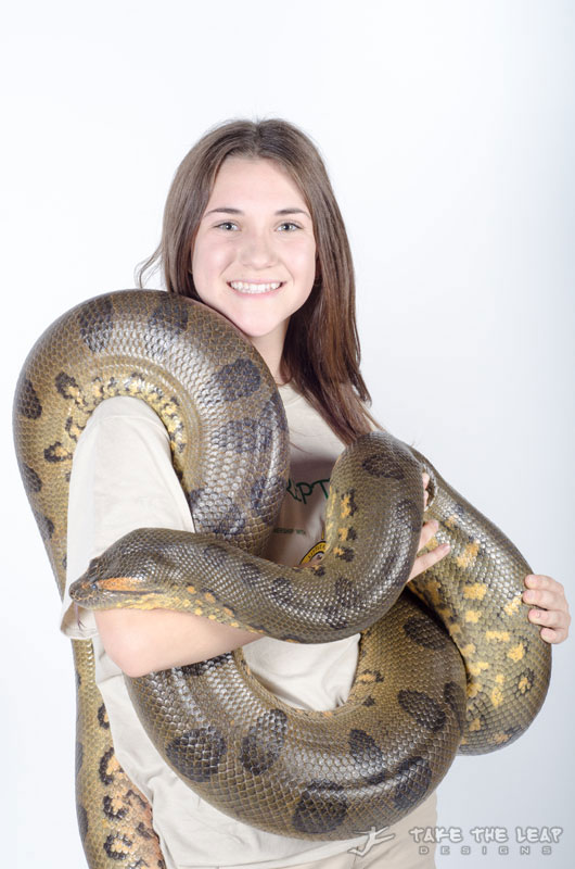 Shelby with Julius, a twelve foot green anaconda.
