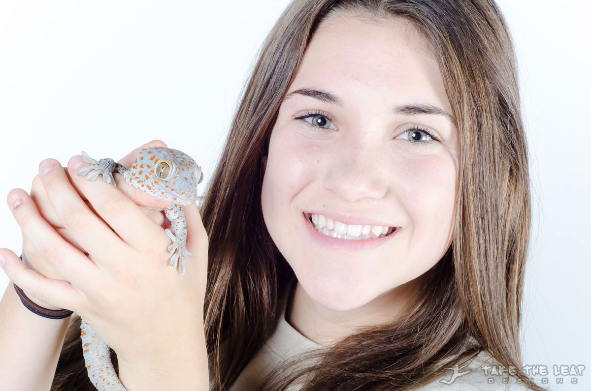 Shelby and a blue and orange spotted tokay gecko.