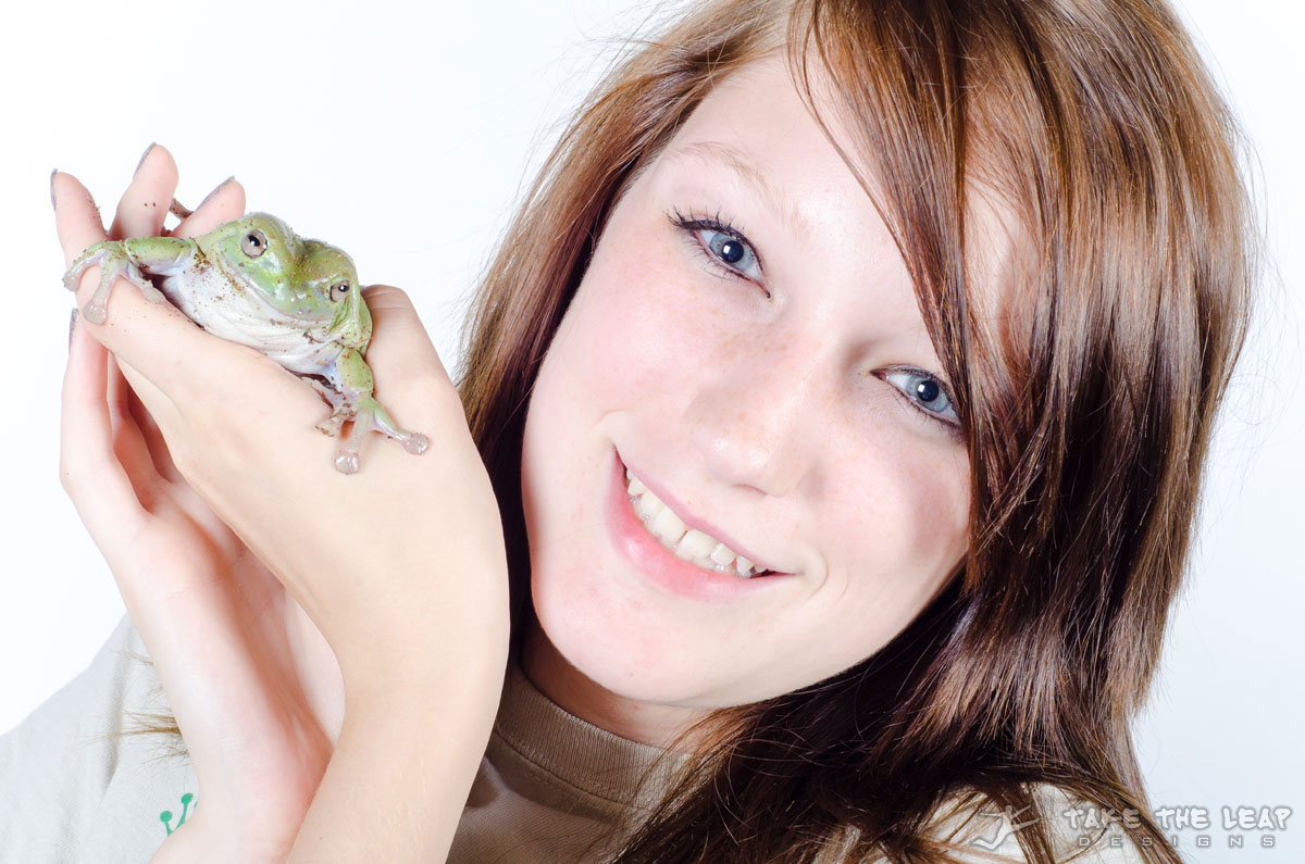 Tayler and a (what looks to be) American green tree frog.