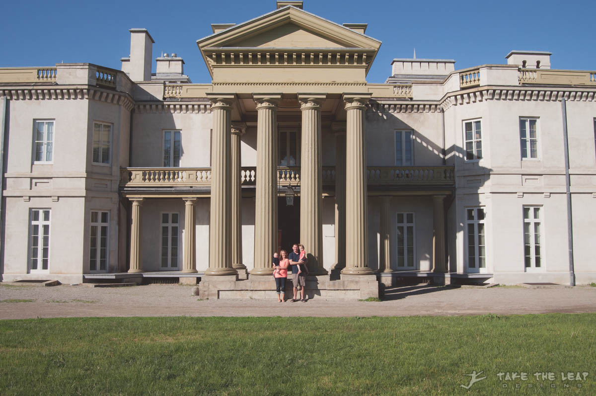 The whole family in front of the picturesque columns of Dundurn Castle.