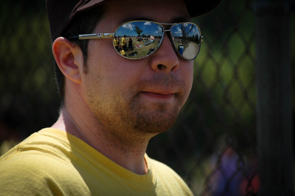 Aaron, during a beverage break, at the 3-pitch summer tournament at Gorley Park. Taken by Aunika Hinks, you can see her reflection in Aaron's sunglasses.